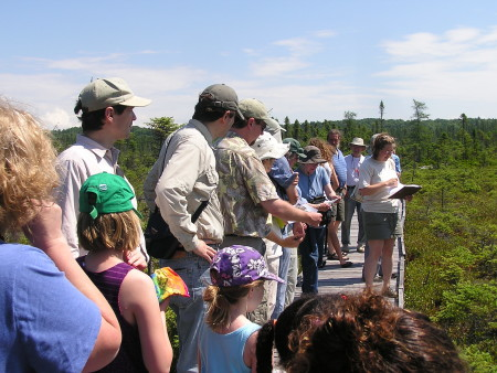 Jen Lund leads a class at the Orono Bog Boardwalk last year. The area is part of the Caribou Bog Corridor Project, an 18,000-acre focus area extending from Essex Street in Bangor along the eastern shore of Pushaw Lake to the inlet of Pushaw Lake in Hudson. CREDIT: Photo by Jerry Longcore.